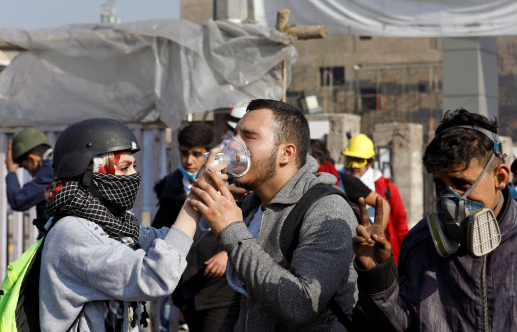 Clashes in Baghdad kill 2 and wound dozens