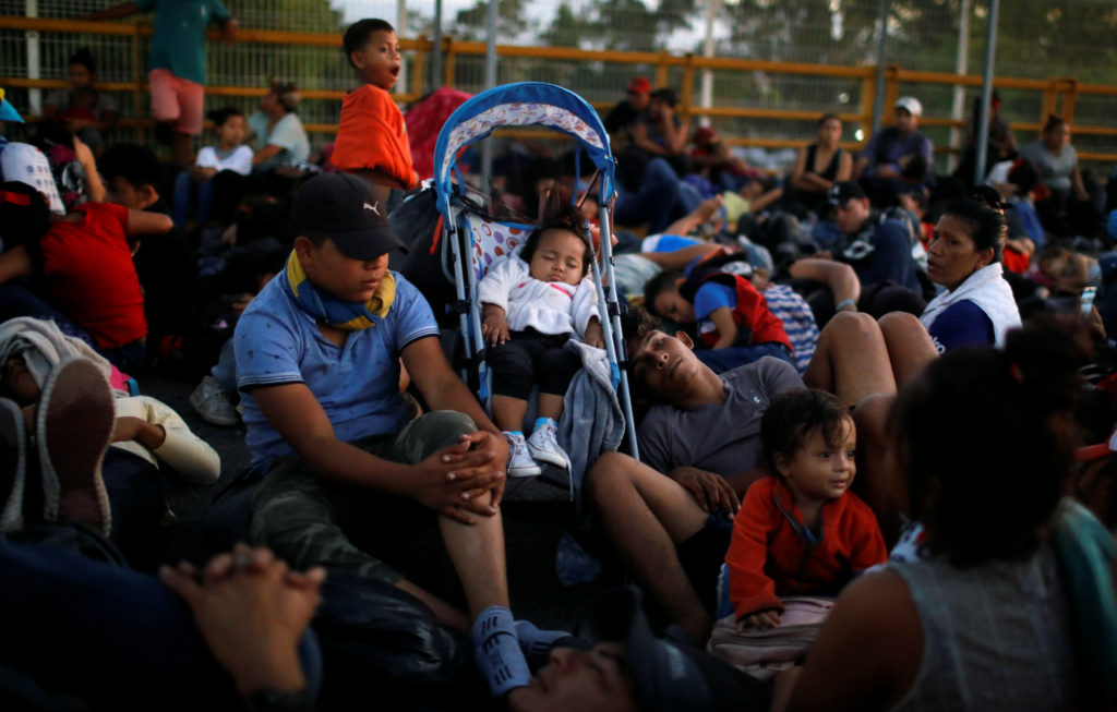Migrants, part of a caravan travelling to the U.S., gather near the border between Guatemala and Mexico, in Tecun Uman, Guatemala, January 20, 2020. Photo by Jose Cabezas/Reuters