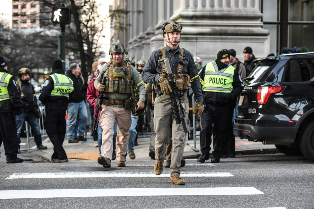 People who are part of an armed militia group walk near the Virginia State Capitol building to advocate for gun rights in Richmond, Virginia, U.S. January 20, 2020. Photo by Stephanie Keith/Reuters