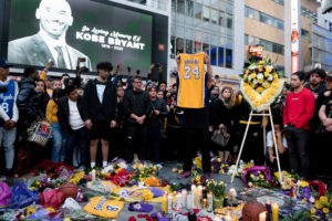 Fans gather at L.A. Live in Los Angeles to pay their respects to former Los Angeles Lakers guard Kobe Bryant who died in helicopter crash on Sunday. Mandatory Credit: Sandy Hooper-USA TODAY