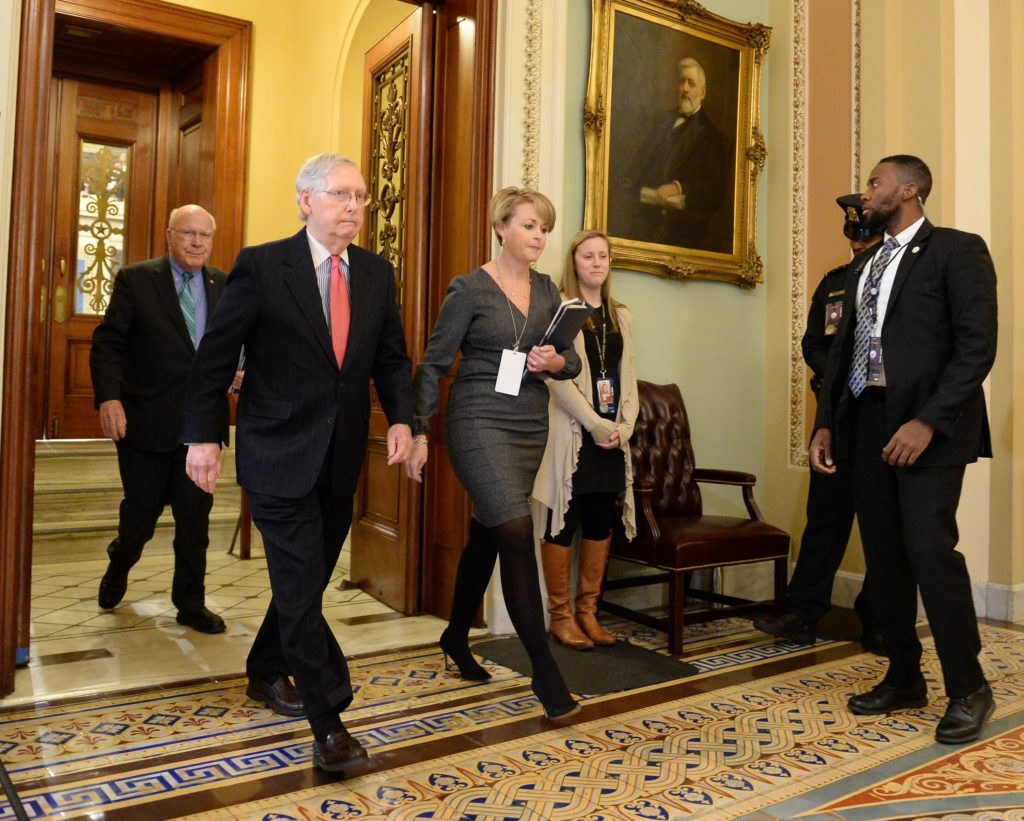 Senate Majority Leader Mitch McConnell, R-Ky., walks from the Senate floor after the end of the day's Senate impeachment t...