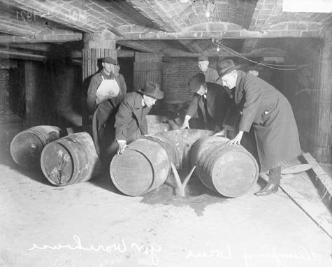 Prohibition agents destroying barrels of alcohol (United States, pr…