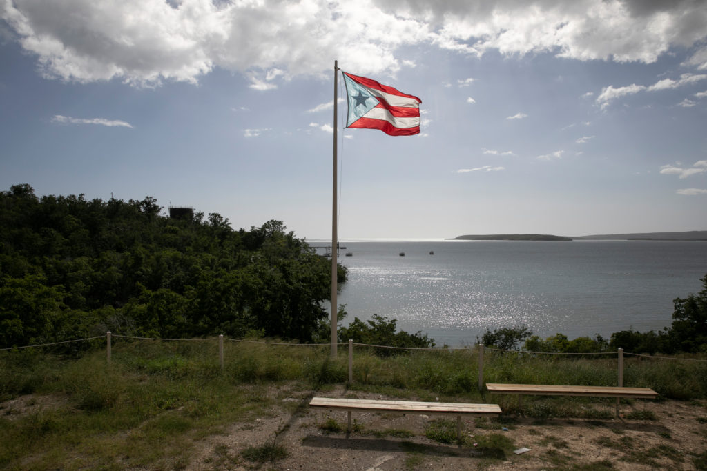A Puerto Rican flag flies in front the bay after the earthquake in Guayanilla, Puerto Rico, January 9, 2020.