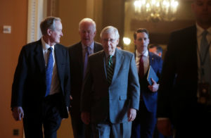 U.S. Senate Majority Leader Mitch McConnell arrives with fellow Republican senators prior to the Senate receiving the House impeachment managers and the procedural start of the impeachment trial of U.S. President Donald Trump at the U.S. Capitol in Washington, U.S., January 16, 2020. REUTERS/Jonathan Ernst - RC25HE9O6MYL