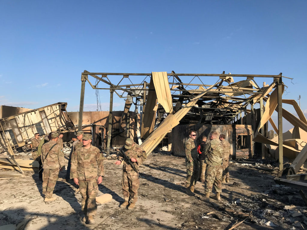 U.S. soldiers inspect the site where an Iranian missile hit at Ain al-Asad air base in Anbar province, Iraq January 13, 20...
