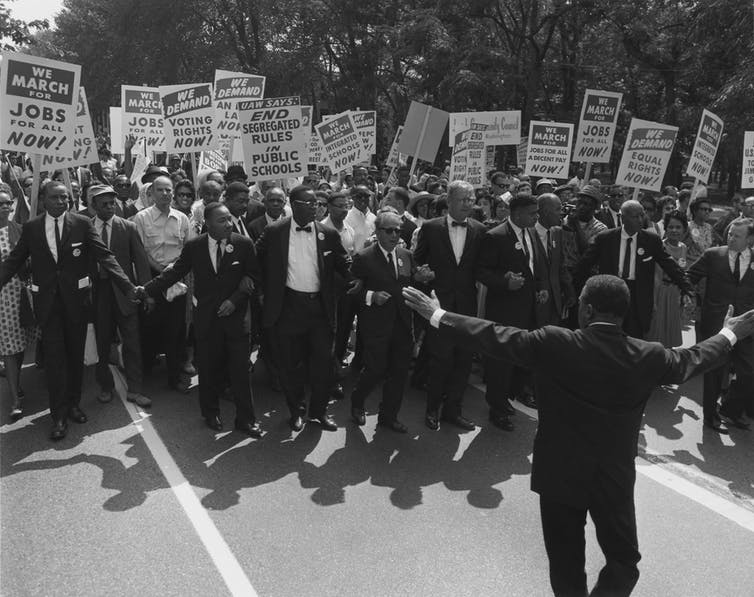 In 1963, 250,000 people marched on Washington to demand equal rights. By 1968, laws had changed. But social progress has since stalled. United States Information Agency