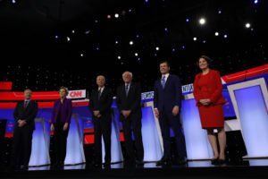 Democratic 2020 U.S. presidential candidates (L-R) billionaire activist Tom Steyer, Senator Elizabeth Warren (D-MA), former Vice President Joe Biden, Senator Bernie Sanders (I-VT), former South Bend Mayor Pete Buttigieg and Senator Amy Klobuchar (D-MN) take the stage for the seventh Democratic 2020 presidential debate at Drake University in Des Moines, Iowa, U.S., January 14, 2020. REUTERS/Brenna Norman