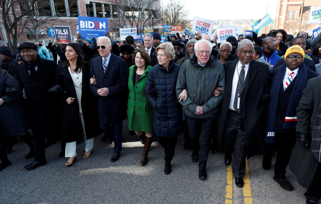 As Iowa approaches, 2020 Democrats highlight differences but push for unity