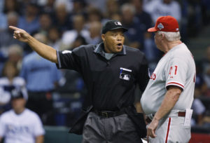 Home Plate umpire Kerwin Danley (L) explains a call to Philadelphia Phillies manager Charlie Manuel after Tampa Bay Rays Rocco Baldelli was awarded a walk in the second inning in Game 2 of Major League Baseball's World Series in St. Petersburg, Florida, October 23, 2008. Photo by Hans Deryk/Reuters