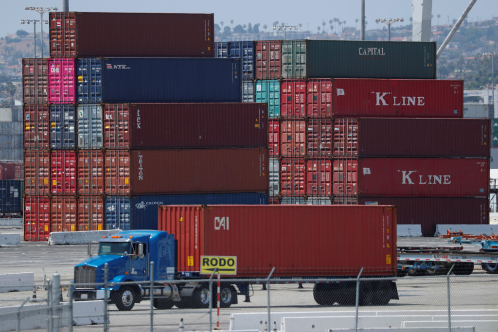 Trucks offload containers from ship at the port of Los Angeles in Los Angeles, California, July 16, 2018. Photo by Mike Blake/Reuters