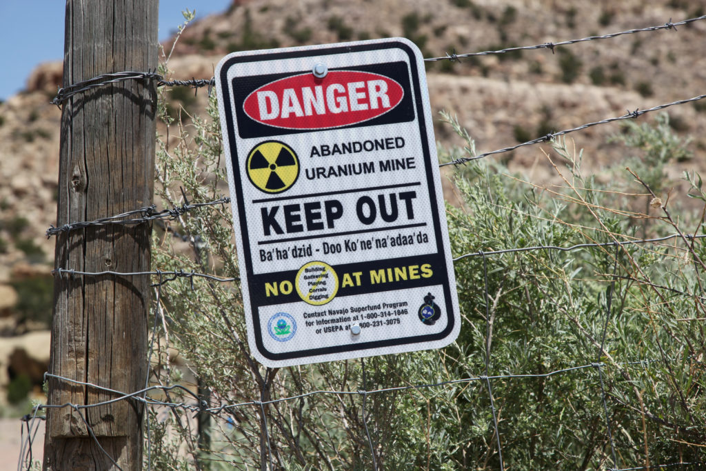 A warning sign is seen next to the entry to the Northeast Church Rock abandoned uranium mine in Pinedale, New Mexico, July 19, 2018. Photo by Pamela J. Peters/Reuters