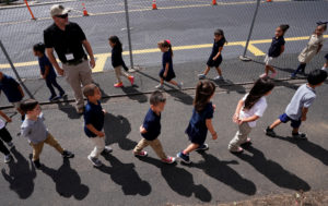 Joe Emery, TAC*ONE trainer and former Las Vegas police department sergeant, leads kindergarten students in evacuation training at Pinnacle Charter School during TAC*ONE training for an active shooter situation in a school in Thornton, Colorado, U.S. August 29, 2019. Photo by REUTERS/Rick Wilking