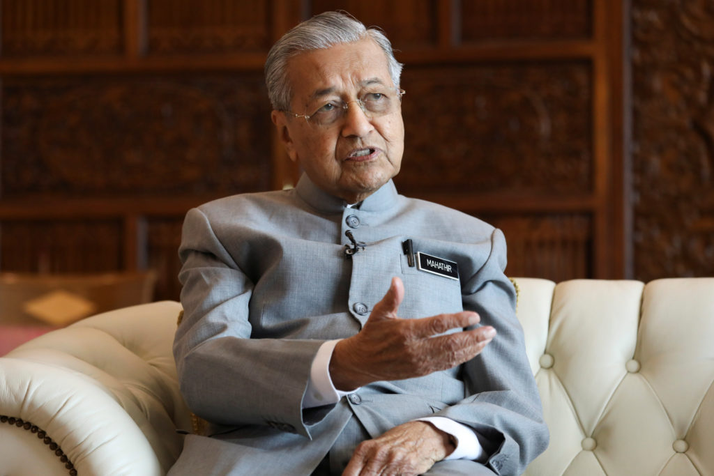 Malaysia's Prime Minister Mahathir Mohamad speaks during an interview with Reuters in Putrajaya, Malaysia, December 10, 20...