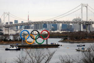 Giant Olympic Rings are installed at the waterfront area, with the Rainbow Bridge in the background, ahead of an official inauguration ceremony, six months before the opening of the Tokyo 2020 Summer Olympic Games, at Odaiba Marine Park in Tokyo, Japan January 17, 2020. Photo by Issei Kato/Reuters