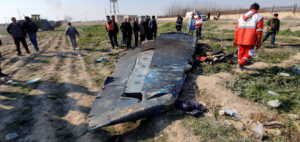 FILE PHOTO: General view of the debris of the Ukraine International Airlines plane that was shot down by Iran's military over the outskirts of Tehran, Iran January 8, 2020 is seen in this screen grab obtained from a social media video via Reuters