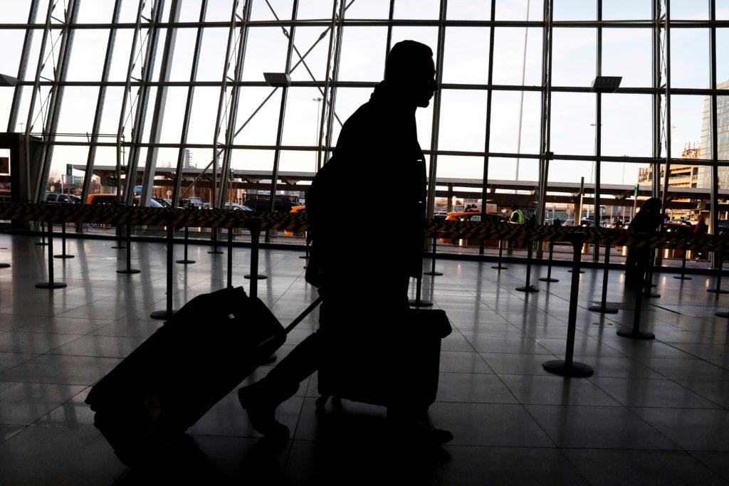 FILE PHOTO: International travelers arrive at John F. Kennedy international airport in New York City, U.S., February 4, 2017. Photo by Brendan McDermid/File Photo