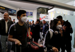 Mexican students wear protective masks upon their arrival at the Del Bajio International Airport, after the Guanajuato state government arranged the return from China for Mexican students due to the coronavirus outbreak, in Silao, Mexico February 1, 2020. Photo by Sergio Maldonado/Reuters
