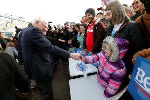 Democratic U.S. presidential candidate Senator Bernie Sanders greets a child and supporters after speaking at a campaign field office in Cedar Rapids, Iowa, U.S., February 2, 2020. Photo by Mike Segar/Reuters