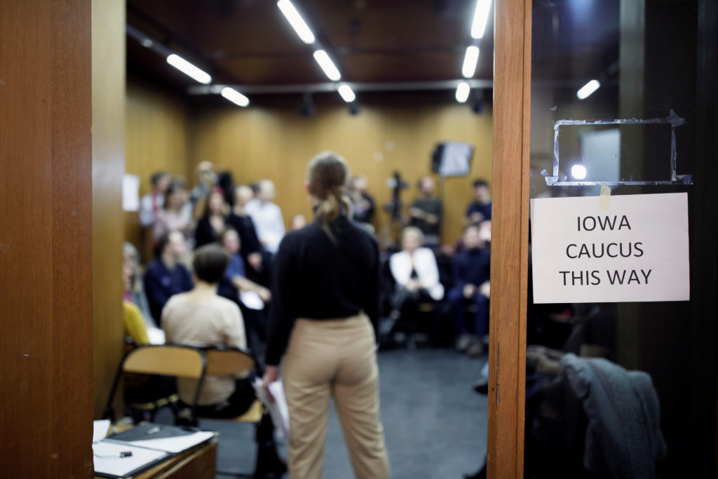 "A placard reading ""Iowa Caucus this way"" is seen during the Iowa Democratic party 2020 satellite caucus in Paris, France, February 3, 2020. Photo by Benoit Tessier/Reuters.."