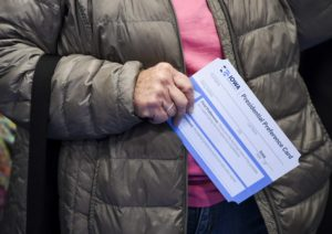 Feb 3, 2020; Larchwood, Iowa, USA; A caucus-goer holds a presidential preference card during the Democratic presidential caucus on Monday, Feb. 3, 2020 in Larchwood, Iowa. Photo by Abigail Dollins/Argus Leader via USA TODAY NETWORK