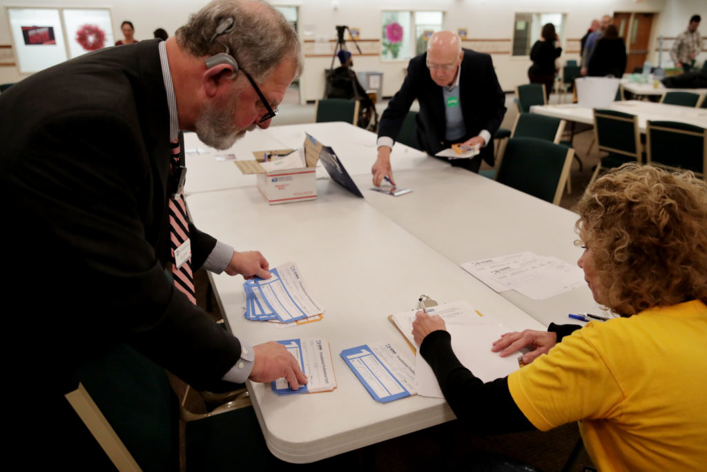 Iowa Caucus precinct workers count and tally Iowa Democratic Caucus votes by hand as caucus votes are counted after a Demo...