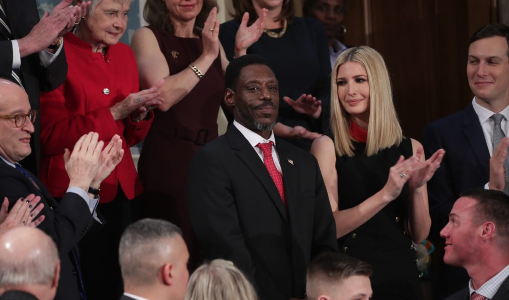 Tony Rankins who lost his job after serving in the U.S. Army is applauded as a guest of U.S. President Donald Trump as he stands next to White House senior advisers Ivanka Trump and Jared Kushner during U.S. President Donald Trump's State of the Union address to a joint session of the U.S. Congress in the House Chamber of the U.S. Capitol in Washington, U.S., February 4, 2020. Photo by Tom Brenner/Reuters