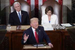 Vice President Mike Pence an Speaker of the House Nancy Pelosi (D-CA) listen as U.S. President Donald Trump delivers the State of the Union address to a joint session of the U.S. Congress in the House Chamber of the U.S. Capitol in Washington, U.S., February 4, 2020. Photo by Joshua Roberts/Reuters.