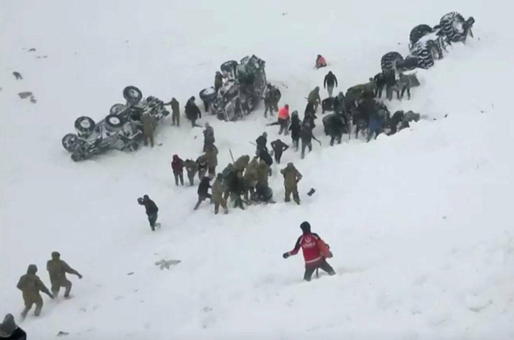 Turkish soldiers and locals try to rescue people trapped under aval…