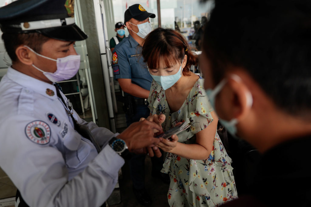 Passengers wearing protective masks, following confirmed cases of c…
