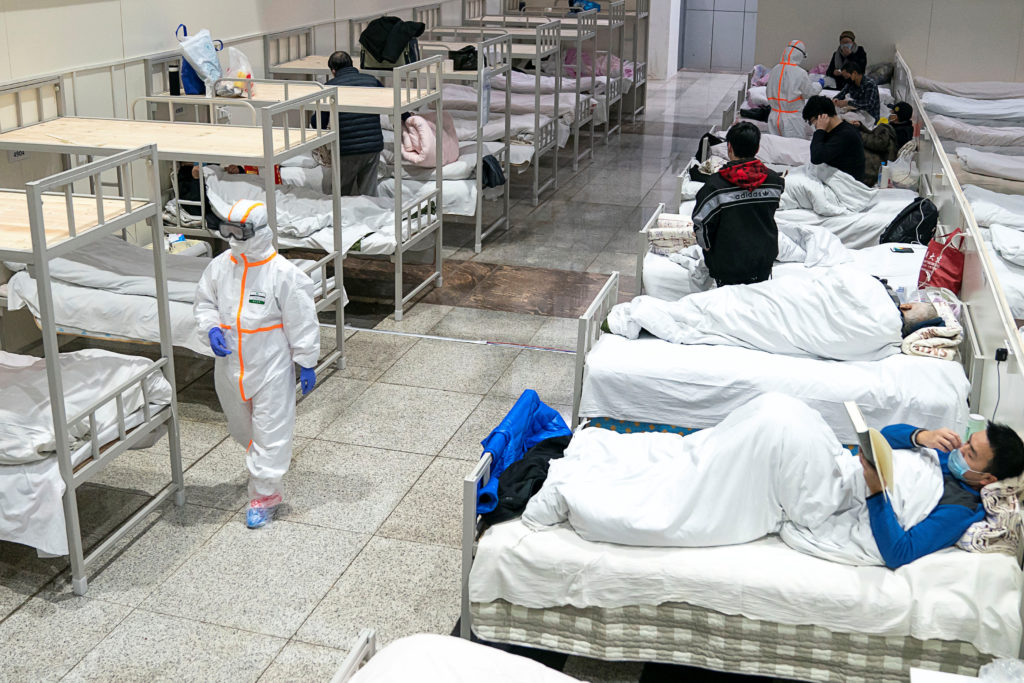 Medical workers in protective suits attend to patients at the Wuhan…