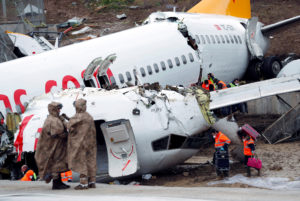 People work at the Pegasus Airlines Boeing 737-86J plane wreckage, after it overran the runway during landing and crashed, at Istanbul's Sabiha Gokcen airport, Turkey February 6, 2020. Photo by Murad Sezer/Reuters