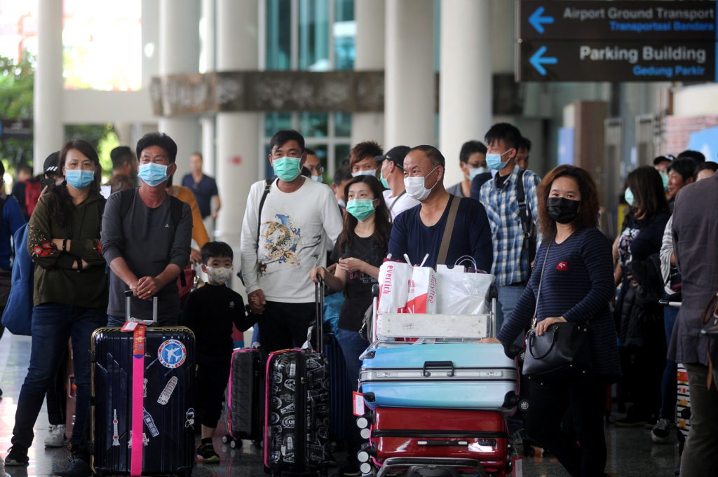 Global tourism takes major hit as virus halts Chinese travel | PBS NewsHour