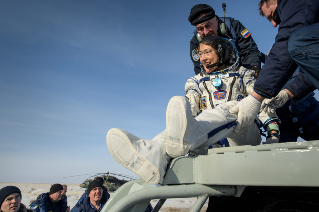 NASA astronaut Christina Koch is helped out of the Soyuz MS-13 spacecraft just minutes after she, Roscosmos cosmonaut Alexander Skvortsov, and ESA astronaut Luca Parmitano, landed their Soyuz MS-13 capsule in a remote area southeast of Zhezkazgan in the Karaganda region of Kazakhstan, February 6, 2020. NASA/Bill Ingalls via Reuters