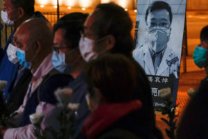 People wearing masks attend a vigil for late Li Wenliang, an ophthalmologist who died of coronavirus at a hospital in Wuhan, in Hong Kong, China February 7, 2020. Photo by Tyrone Siu/Reuters