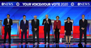 Democratic 2020 U.S. presidential candidates entrepreneur Andrew Yang, former South Bend Mayor Pete Buttigieg, Senator Bernie Sanders, former Vice President Joe Biden, Senator Elizabeth Warren, Senator Amy Klobuchar and billionaire activist Tom Steyer pose together onstage at the Democratic 2020 U.S. presidential candidates debate in Manchester, New Hampshire, U.S., Feb 7, 2020. Photo by Brian Snyder/Reuters
