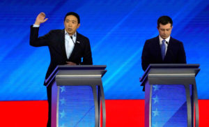 Entrepreneur Andrew Yang speaks as South Bend Mayor Pete Buttigieg listens at the Democratic 2020 U.S. presidential candidates debate in Manchester, New Hampshire, U.S., Feb 7, 2020. Photo by Brian Snyder/Reuters