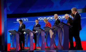 Democratic 2020 U.S. presidential candidates (L-R) entrepreneur Andrew Yang, former South Bend Mayor Pete Buttigieg, Senator Elizabeth Warren (D-MA), former Vice President Joe Biden, Senator Bernie Sanders (I-VT), Senator Amy Klobuchar (D-MN) and billionaire activist Tom Steyer participate in the eighth Democratic 2020 presidential debate at Saint Anselm College in Manchester, New Hampshire, U.S., February 7, 2020. Photo by Brendan Mcdermid/Reuters