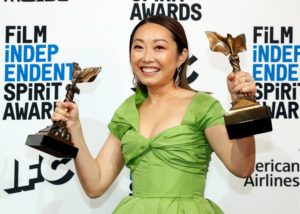 "Lulu Wang poses backstage with the award for Best Feature for the film ""The Farewell"" and for Best Supporting Female which she accepted on behalf of Zhao Shuzhen, also for ""The Farewell."" Photo by Lucas Jackson/Reuters"