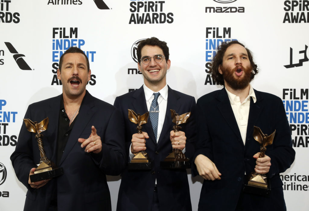 "(L-R) Adam Sandler holds his Best Male Lead award as he poses backstage with Benny Safdie and Josh Safdie with their Best Director awards, all for ""Uncut Gems. Photo by Reuters"