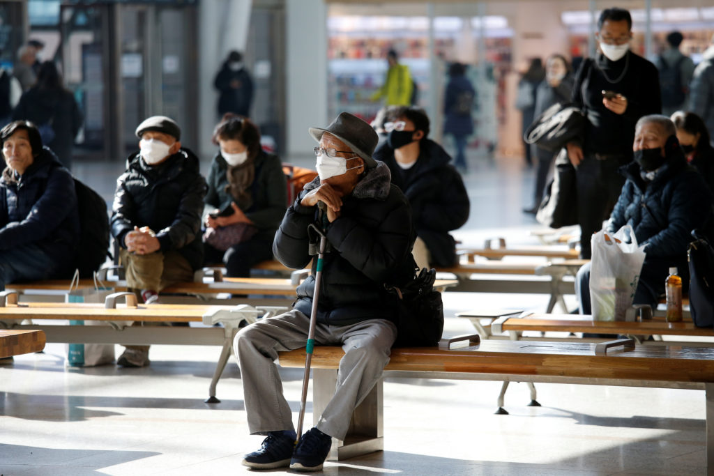A men wears a mask to protect himself against a new coronavirus at …
