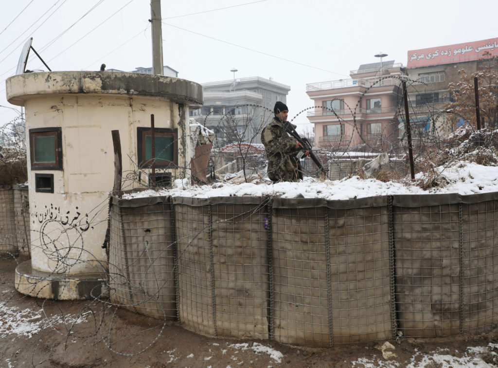 An Afghan National Army (ANA) soldier keeps watch at a check point near the site of a suicide attack in Kabul, Afghanistan...