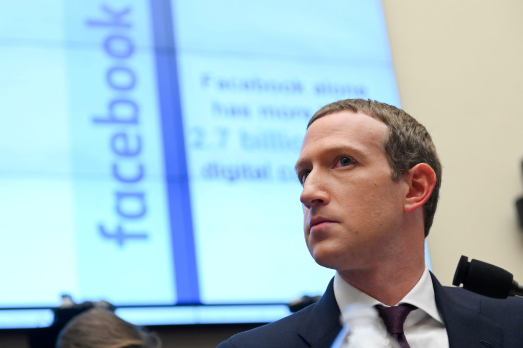 FILE PHOTO: Facebook Chairman and CEO Mark Zuckerberg testifies at a House Financial Services Committee hearing in Washington, U.S., October 23, 2019. Photo by Erin Scott/Reuters