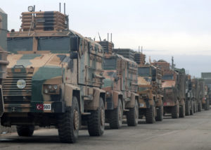 Turkish military vehicles are seen in Hazano near Idlib, Syria, February 11, 2020. Photo by Khalil Ashawi/Reuters