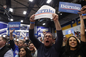 Supporters cheer as Democratic U.S. presidential candidate Senator Bernie Sanders arrives to speak at his New Hampshire primary night rally in Manchester, N.H., U.S., February 11, 2020. Photo by Mike Segar/Reuters