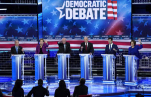 All of the 2020 Democratic presidential candidates, former New York City Mayor Mike Bloomberg, Senator Elizabeth Warren, Senator Bernie Sanders, former Vice President Joe Biden, former South Bend Mayor Pete Buttigieg and Senator Amy Klobuchar, try to speak at the same time near the conclusion or the ninth Democratic 2020 U.S. presidential candidates debate at the Paris Theater in Las Vegas, Nevada, February 19, 2020. Photo by Mike Blake/Reuters