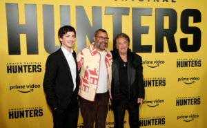 "Executive producer Jordan Peele and cast members Logan Lerman and Al Pacino pose at a premiere for the television series ""Hunters"" in Los Angeles, California, February 19, 2020. Photo by Mario Anzuoni/Reuters"