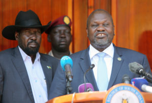 South Sudan's ex-vice President and former rebel leader Riek Machar flanked by President Salva Kiir Mayardit address a news conference at the State House in Juba, South Sudan on February 20, 2020. Photo by Jok Solomun/Reuters