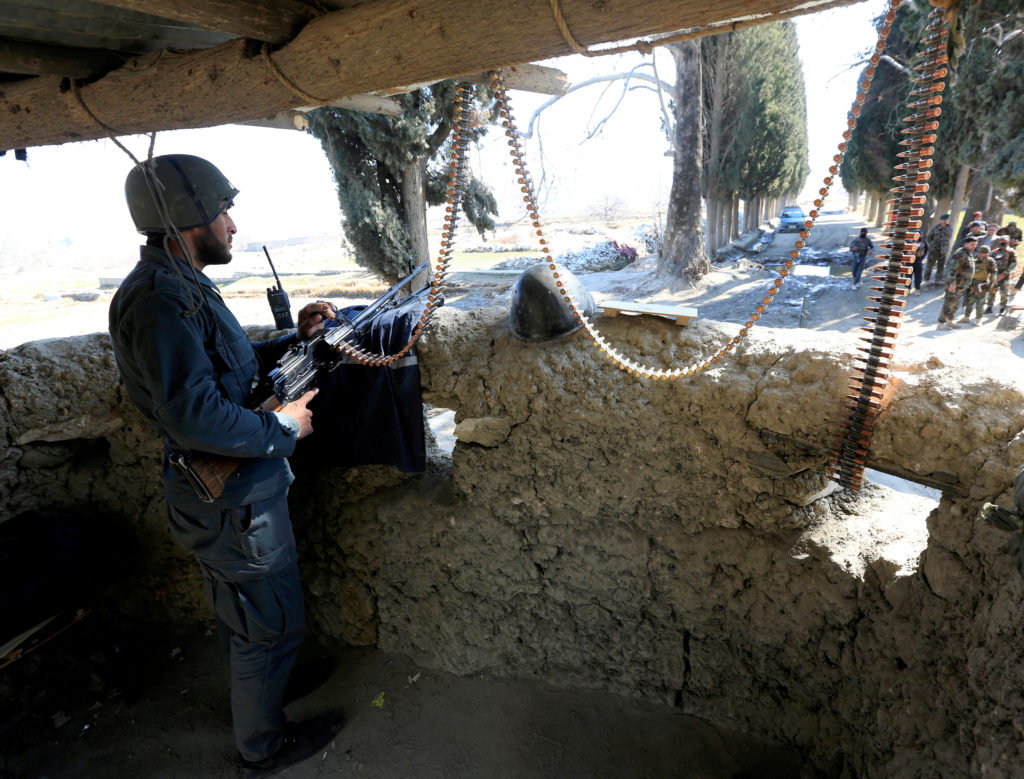 FILE PHOTO: An Afghan security force member stands guard at a security tower where two U.S soldiers were killed a day befo...
