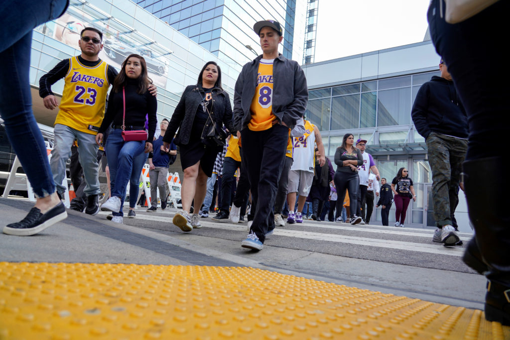 Fans wait in line before the public memorial for NBA great Kobe Bryant, his daughter and seven others killed in a helicopter crash, at the Staples Center in Los Angeles, California, U.S., February 24, 2020. Photo by Kyle Grillot/Reuters