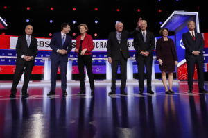 Democratic 2020 U.S. presidential candidates (L-R) former New York City Mayor Michael Bloomberg, former South Bend Mayor Pete Buttigieg, Senator Elizabeth Warren, Senator Bernie Sanders, former Vice President Joe Biden, Senator Amy Klobuchar and billionaire activist Tom Steyer take the stage for the tenth Democratic 2020 presidential debate at the Gaillard Center in Charleston, South Carolina, U.S. February 25, 2020. Photo by Randall Hill/Reuters